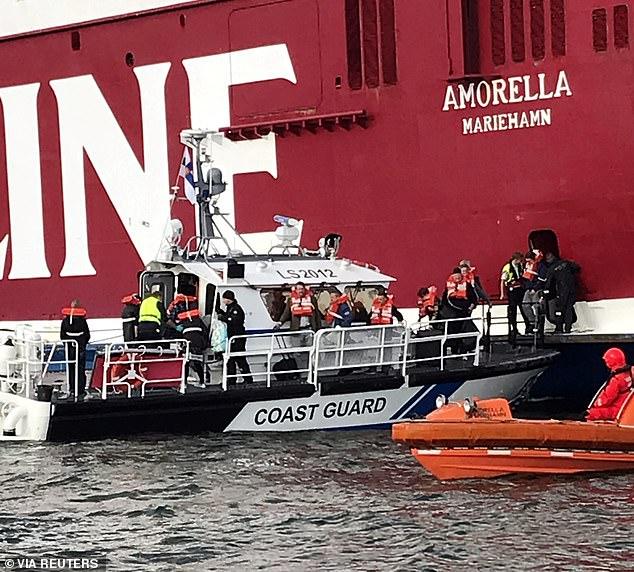 Passengers evacuating theViking Line's cruiseferry MS Amorella, near Langnas, Aland Islands, Finland on Sunday