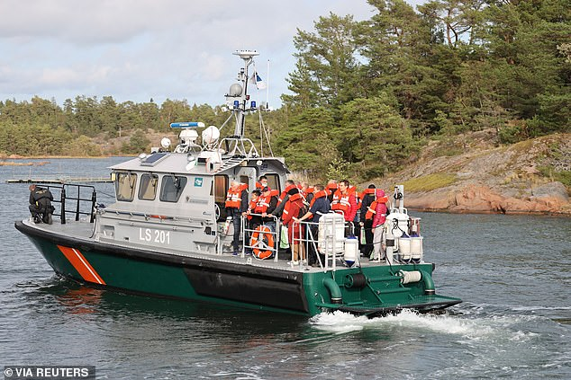 Passengers are ferried off the MS Amorella after it ran aground on the Aland Islands on Synday