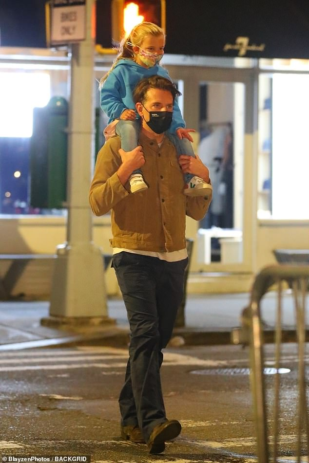 Loving father: Bradley Cooper, 45, carried his adorable daughter Lea, three, on his shoulders as they left dinner on Friday in Manhattan's West Village