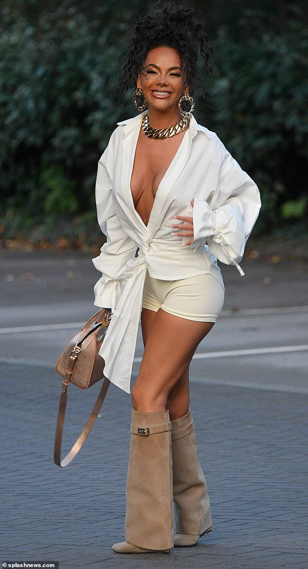 Wow:Chelsee Healey, 32, put on a jaw-dropping display in a low-cut white wrap shirt as she stepped out for an evening at San Carlos in Hale, Cheshire, on Sunday