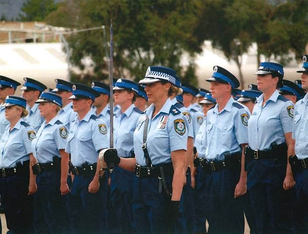 Wallace went on to have a distinguished career in the New South Police Force, receiving the Australian Police Medal and retiring in December last year. She is pictured with sword on parade