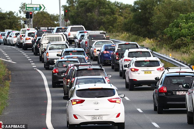 Cities like Perth and Brisbane even recorded higher numbers of people driving on the road compared to pre COVID-19 (pictured, traffic at the Queensland border in March as COVID-19 panic and restrictions began to sink in)