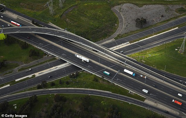 Melbourne is the only city in Australia that has not returned to normal levels of car traffic as it battles through the harshest COVID-19 lockdown in the country, new data reveals (pictured, a quiet Western Ring Road and Tullamarine Freeway in Melbourne)