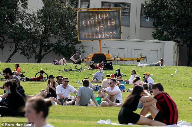 Opposition MPs want restrictions relaxed faster as the lockdown threatens to put up to 400,000 Victorians out of work by Christmas. Pictured: A Melbourne park on Saturday