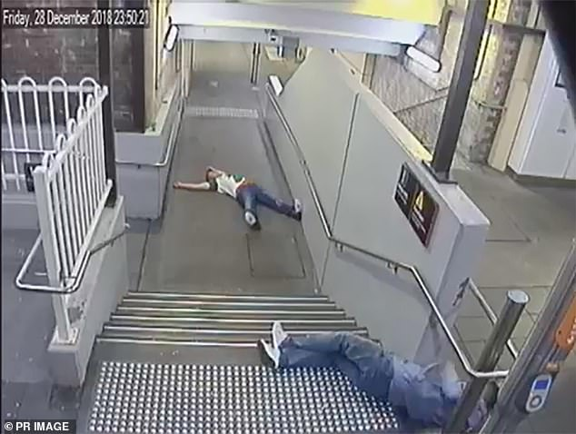 CCTV images of Nathan Kelly, 23, and Christopher McLaughlin, 25, laying on the floor of Summer Hill train station