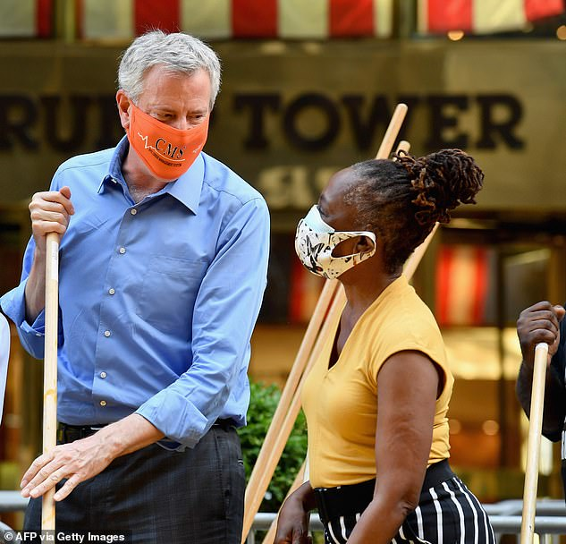 De Blasio and his wife Chirlane McCray are seen painting a Black Lives Matter mural in July