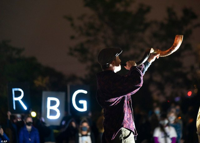 MINNEAPOLIS: A man blows a shofar to hono Ginsberg at the beginning of a memorial service where her initials are lit up in lights