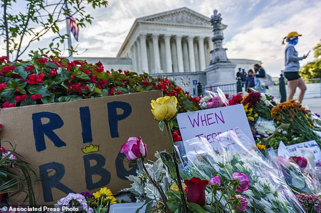 People gather at the Supreme Court on the morning after the death of Justice Ruth Bader Ginsburg, 87, Saturday in Washington D.C.