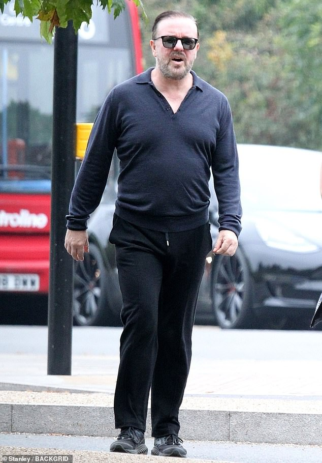 Stepping out:Ricky Gervais and his partner Jane Fallon were seen out and about in London on Monday after the author revealed they previously lived in a brothel