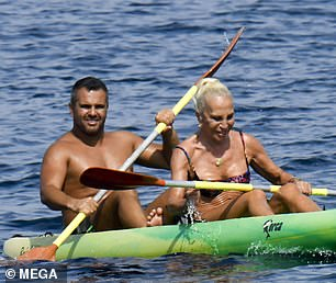 Going for it: Donatella was in good spirits as she kayaked with her friend
