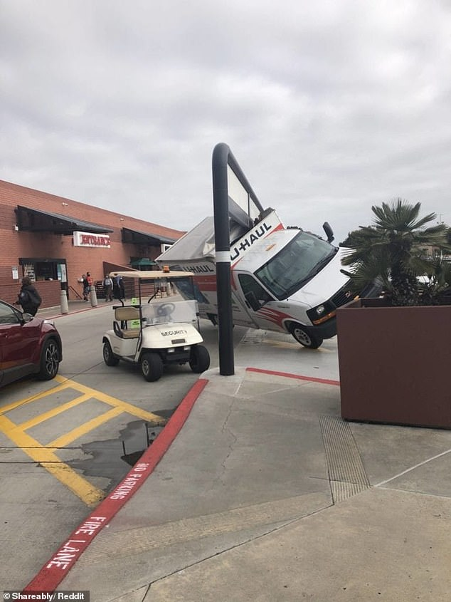 A driver believed to be in the U.S. found themselves in desperate need of assistance, and good insurance, after their vehicle got stuck under a road sign