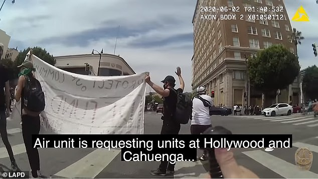 Footage shows the man - who later identified himself asBen Montemayor - standing in the middle of a crosswalk with his arms raised in the air