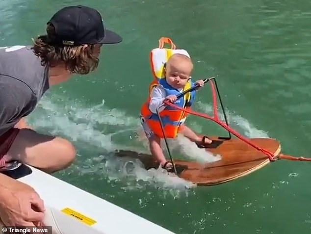 Controversy: Rich Humpherys broke the world record for the youngest person to ever water ski at the age of six months - however the stunt has sparked outrage on social media