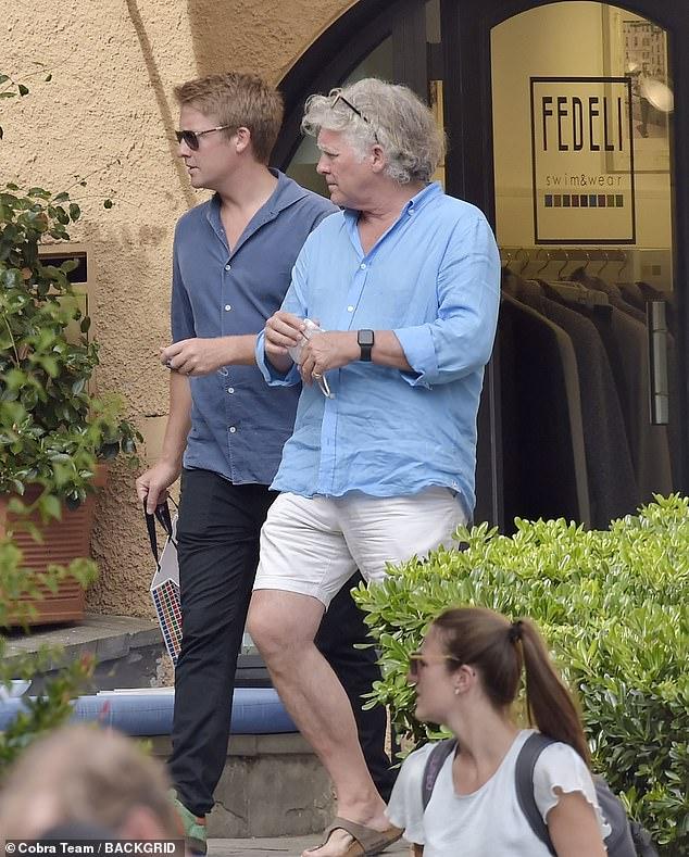 Still enjoying a summer break, Hugh Grosvenor (pictured left), 29, was spotted taking a stroll through the Italian village today