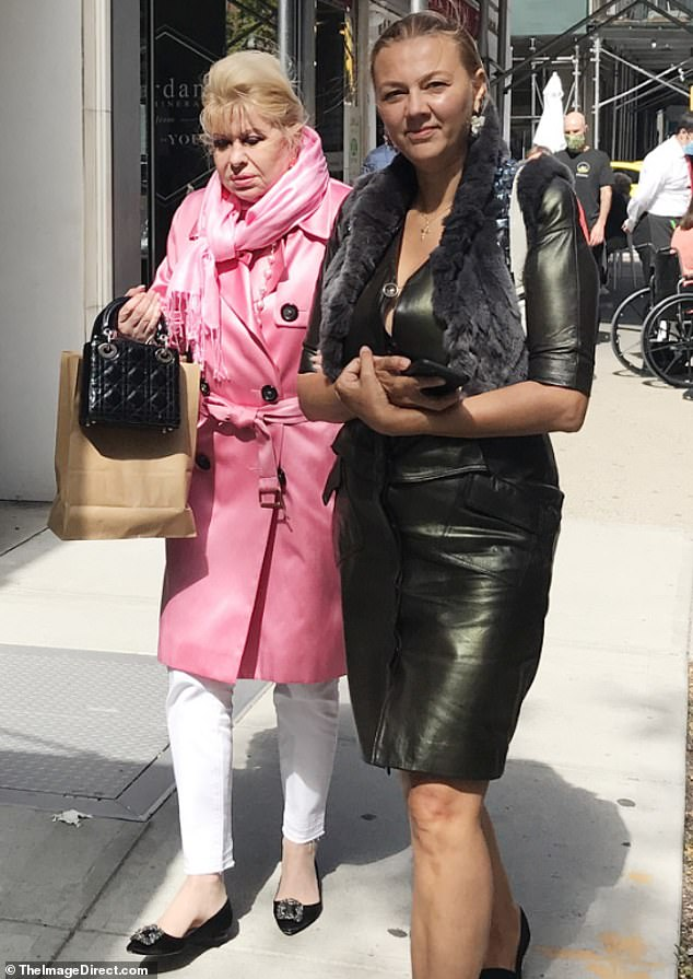 Outfit of the day:Ivana stood out in a pink satin trench coat and a matching scarf, which paired with white skinny jeans and black flats with crystal buckles