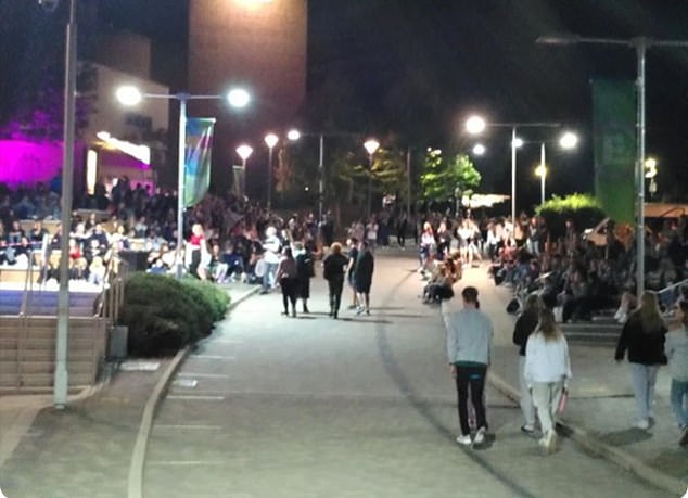 Large groups of people attended an officially socially distanced outdoor cinema event held on campus