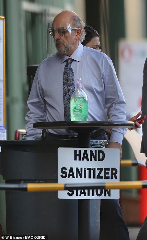 Safety first: Richard Schiff was seen standing next to hand sanitizer stations while on set