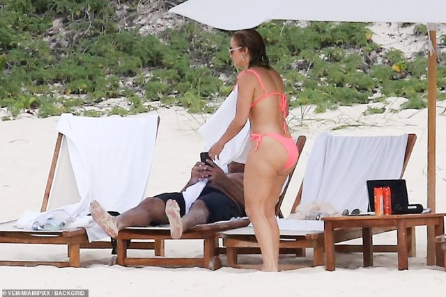 Drying off: Back on the sand, the Academy Award nominated star wrapped up in a plush white towel