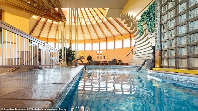 Odak attributes the indoor-outdoor foyer pool (pictured) with creating enough humidity to stop the furniture-grade woodwork inside the home from cracking in Boulder's dry air