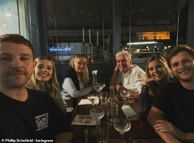 Support:'It's surprising how you think you've got a grip on everything and suddenly your head takes you to dark and scary places,' he added (pictured with his family and his daughters' partners recently)