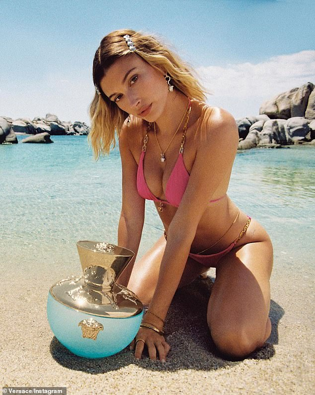'Hailey captures the fresh and youthful nature': Bieber has to maintain a taut body in order to front fashion campaigns like Versace's 'Dylan Turquoise Pour Femme' fragrance, which was shot in June on a remote island off the coast of Sardinia