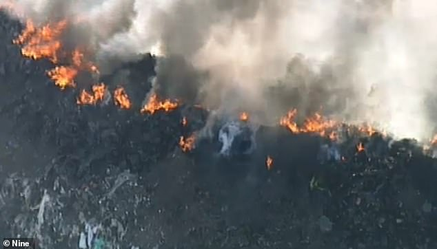 A huge fire has ravished out of control at a rubbish tip causing thick, black smoke to engulf parts of Melbourne