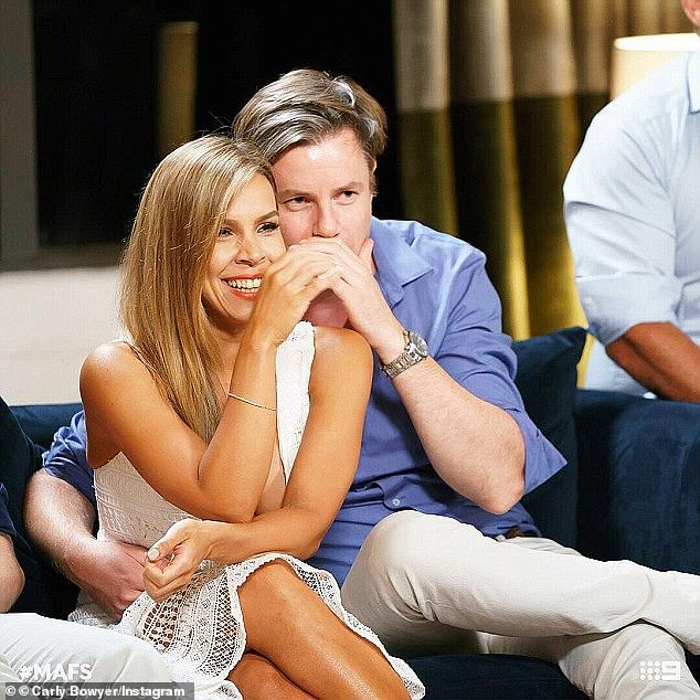 Too many twists to handle! Elsewhere, fans expressed their shock after unlikely couple Carly Bowyer (left) and Troy Delmege (right) debuted their relationship with a steamy PDA-session