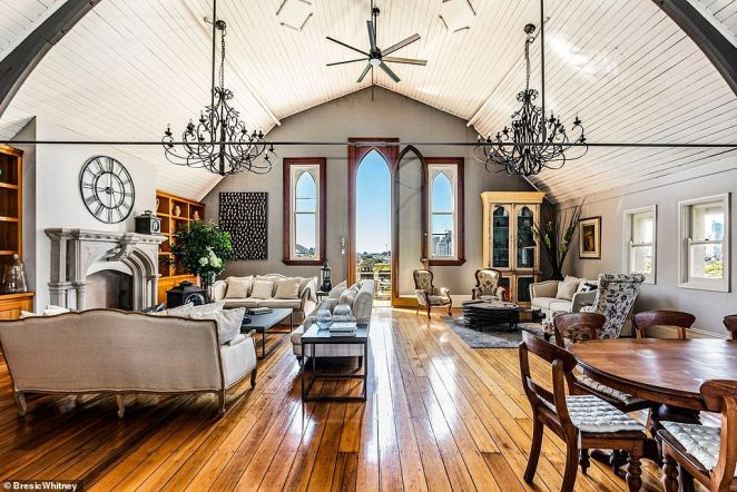 Vaulted ceilings tower eight metres above the living room, decorated in a Gothic style in a nod to the building's heritage