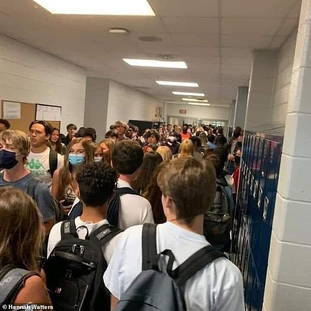 Images shared earlier this month showed few students wearing masks in the crowded hallways in North Paulding High School in Georgia