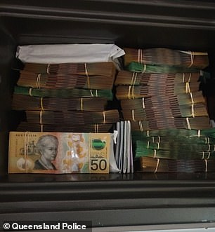 Queensland Police seized drugs and a large sum of cash (pictured) during raids at two medical practices in Fortitude Valley and Chermside, on Tuesday