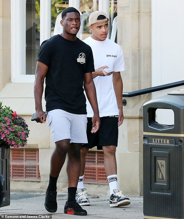 Fresh start:Manchester United striker Mason Greenwood put a difficult two weeks behind him on Monday as he ventured out with teammate Teden Mengi in Cheshire