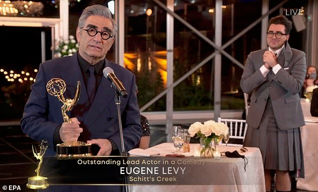 History: Comedy topped the annual Emmy Awards, winning nine trophies out of 15 nominations and sweeping through all major comedy categories. Daniel Levy applauded when his famous father won his first acting Emmy for his role