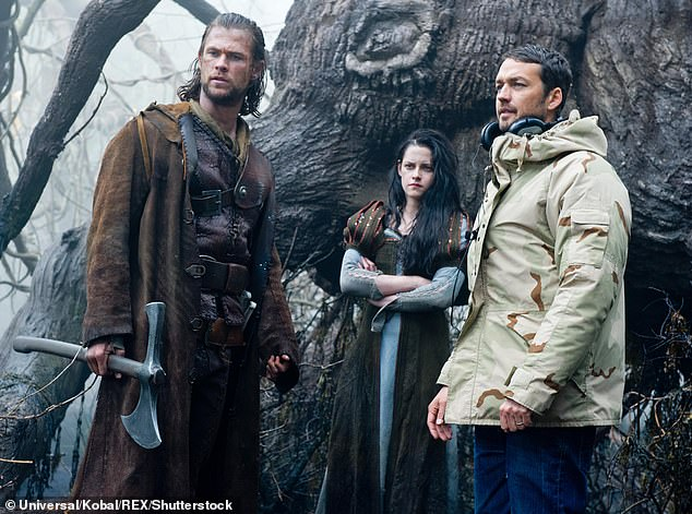 Split: For Kristen, it led to her split with her then-boyfriend, Twilight co-star Robert Pattinson. Pictured left to right isChris Hemsworth, Kristen Stewart and Rupert Sanders on the set of Snow White and The Huntsman