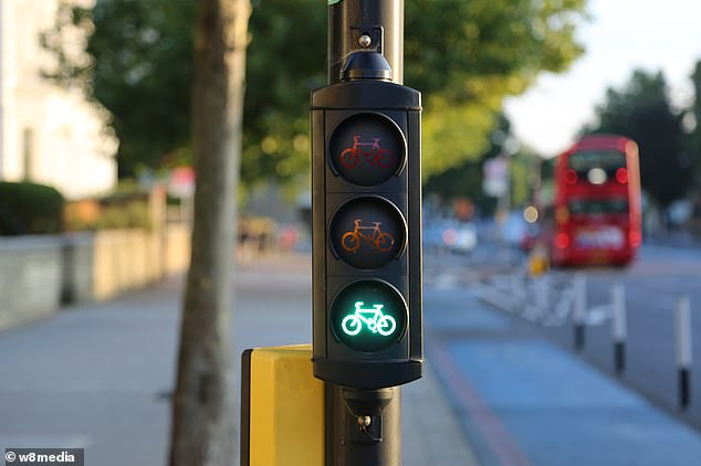 A green traffic light for bicycles in Tooting, South London, amid controversy over the implementation of cycle lanes