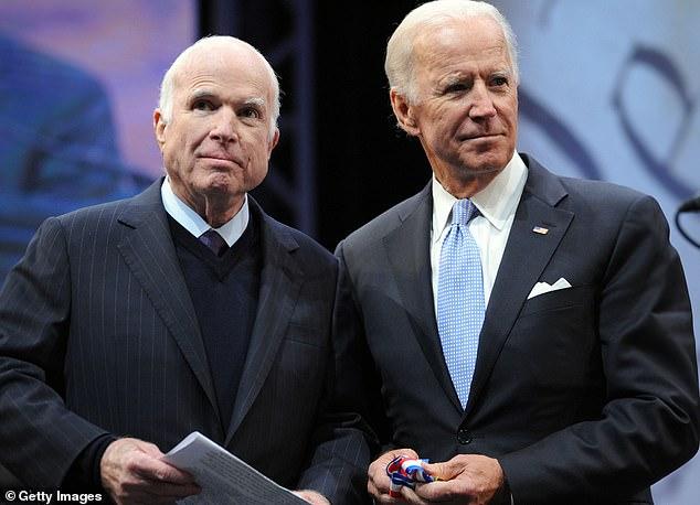 Sen. John McCain (R-AZ) receives the the 2017 Liberty Medal from former Vice President Joe Biden at the National Constitution Center on October 16, 2017 in Philadelphia, Pennsylvania