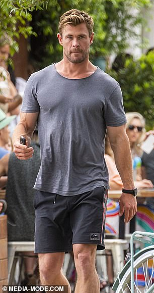 Cool and collected: Thor actor Chris, meanwhile, opted for a casual grey T-shirt and a pair of shorts
