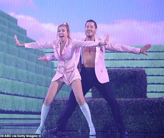 Shaking it:Monica Aldama, 50, the head coach on Netflix's hit show Cheer, did a jive to Taylor Swift's Shake It Off with Val Chmerkovskiy, 34