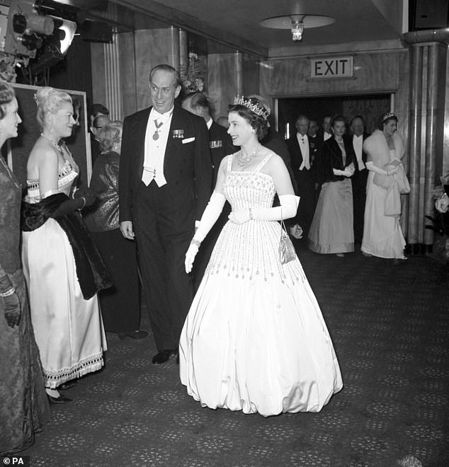 The Queen first wore the taffeta gown for a state dinner at the British Embassy in Rome during a visit in 1961