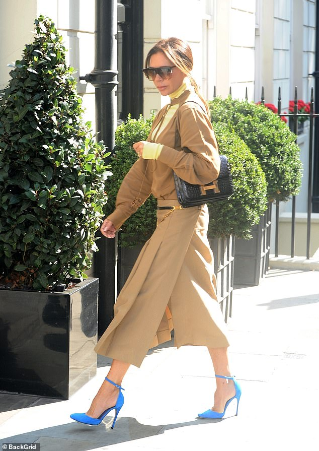 Silver, silver, silver: Posh amplified the glamor with a Hermès handbag