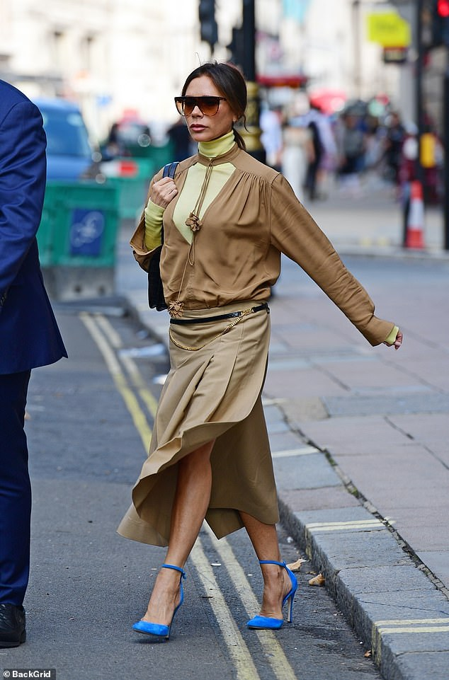 Turn heads: Posh looked at the fashion maven every inch as she headed for lunch in a super stylish khaki ensemble