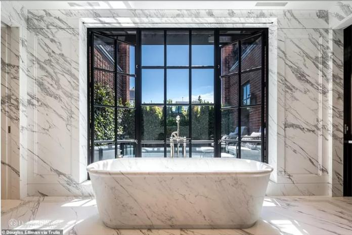 The master bathroom has a soaking tub that looks straight onto one of the loft's private terraces