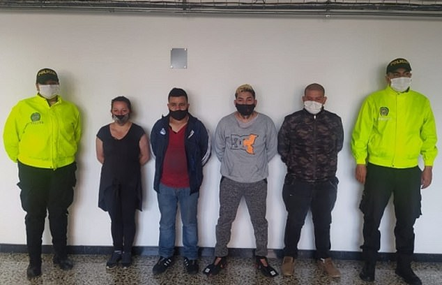 Silvia Yaney Castañeda (second from left), Danilo Pacheco (third from left),Exyerin David Vargas (third from right) y Leonardo Jesús Vargas (second from right) were charged withhuman trafficking, torture and instigating prostitution after they were arrested in Bogotá, Colombia, on Sunday