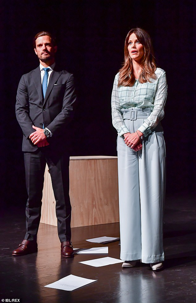 Sofia, pictured on stage with Carl, wore matching court heels teamed with a grey leather handbag and wore minimal jewellery, other than her wedding rings