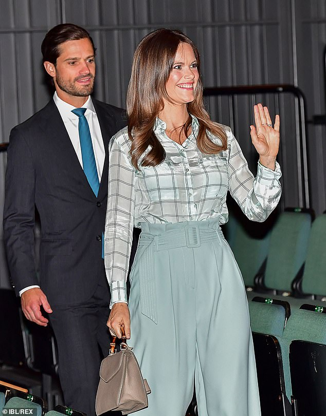 Princess Sofia looked pleased as she waved to royal fans while entering the theatre, with husband Carl close behind her