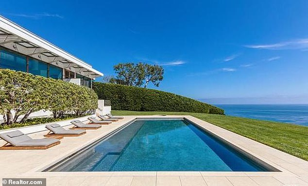 The five-bedroom, six-bathroom home has a pool overlooking Paradise Cove, a tennis court and a two-story library