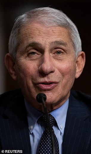 Redfield and Dr Anthony Fauci (pictured) said they expect 700 million doses of a COVID-19 vaccine will be available by spring 2021. Pictured: Fauci testifies before the Senate, Wednesday