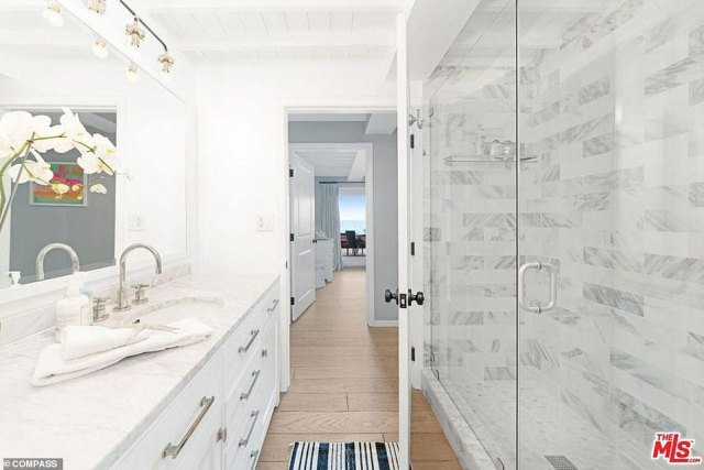 Bright and white: A family bath also has a shower and a vanity