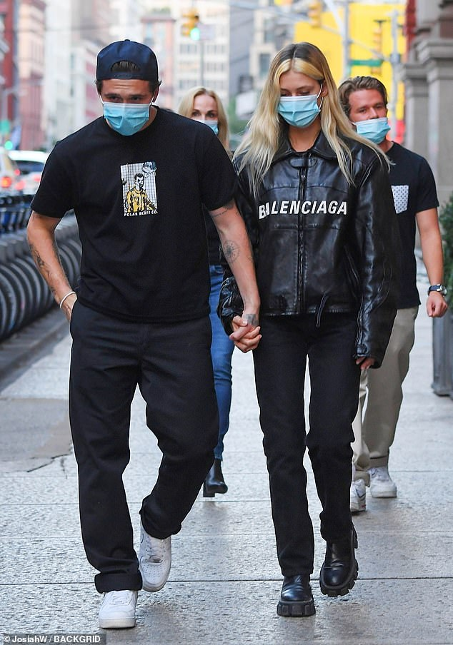 Loved up: Brooklyn Beckham, 21, and his fiancée Nicola Peltz, 25, continued to look as loved up as ever on Wednesday, when they stepped out for a stroll in New York City