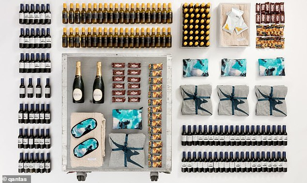Each pre-loved cart comes complete with 40 mini bottles of red wine, 40 mini bottles of white and a bottle of Champagne from the airline's business class cellar, Tim Tams, pajamas and an exclusive-to-Qantas first class Sheridan throw