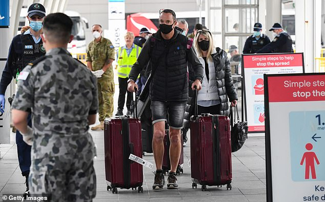 There are almost 36,000 Australians stranded overseas trying to get home, an increase of more than 10,000 in less than a week (pictured, people returning on a domestic flight in August)
